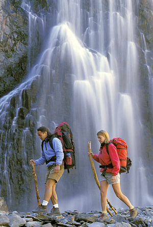 Couple hiking by waterfall
